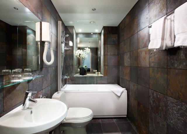 bathroom property sink toilet home shower plumbing fixture public toilet tub tiled tile bathtub Bath