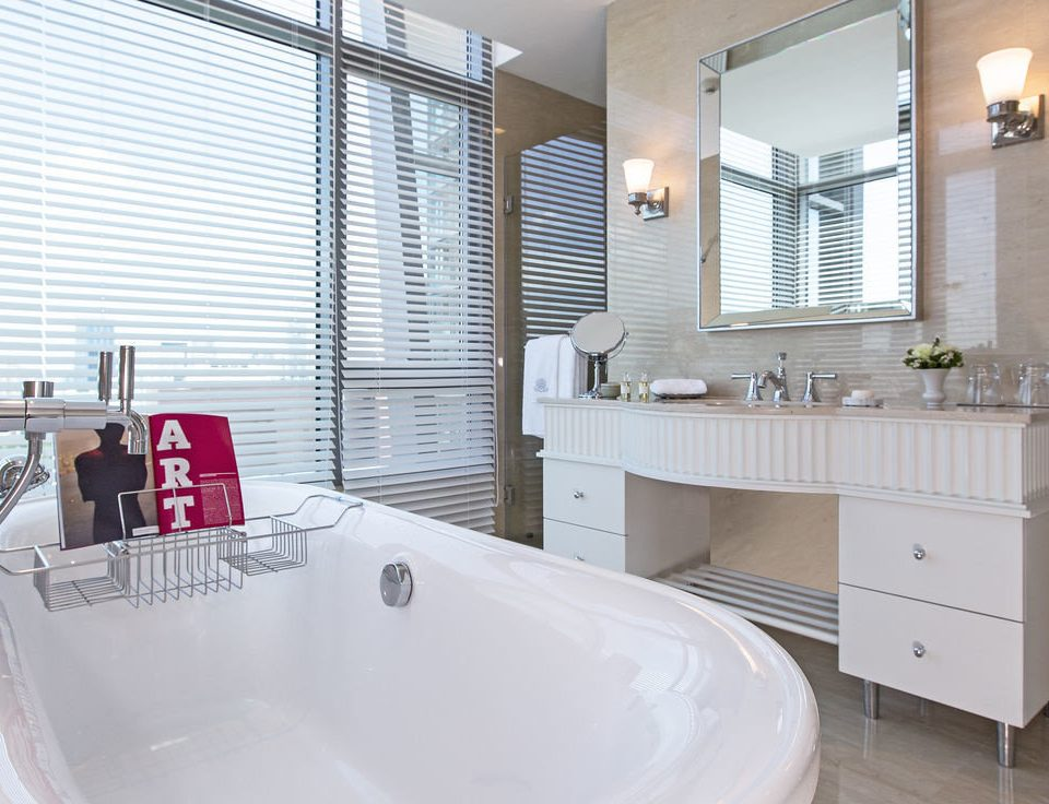 bathroom property bathtub vessel swimming pool sink home tub plumbing fixture Bath