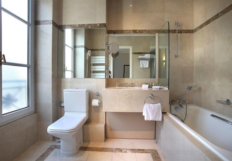 bathroom property house home toilet sink plumbing fixture tub tan bathtub Bath
