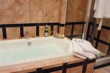 bathroom swimming pool sink property jacuzzi bathtub vessel tub plumbing fixture tile tiled Bath