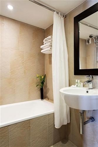 bathroom sink mirror property tub plumbing fixture bathtub tile Bath tiled