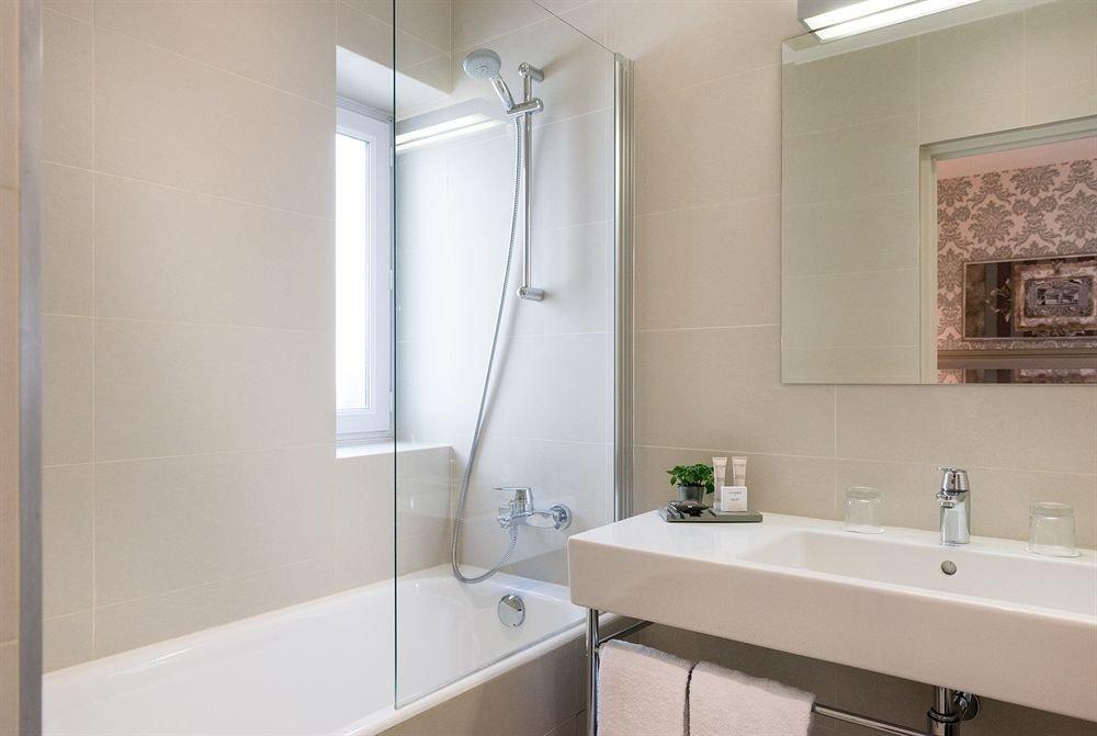bathroom sink mirror property vessel toilet white plumbing fixture tub bathtub tile Bath water basin tiled
