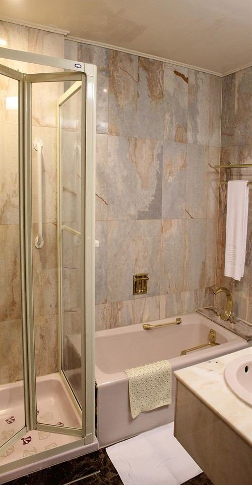 bathroom plumbing fixture sink shower bathtub tub Bath tan tiled