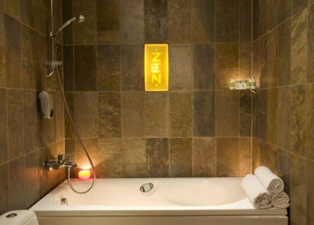 bathroom plumbing fixture swimming pool sink toilet bathtub tub tiled Bath tile