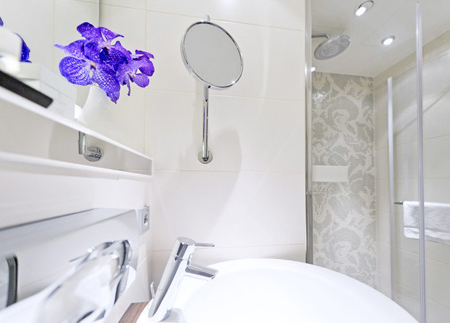bathroom toilet white plumbing fixture tub bathtub Bath tiled