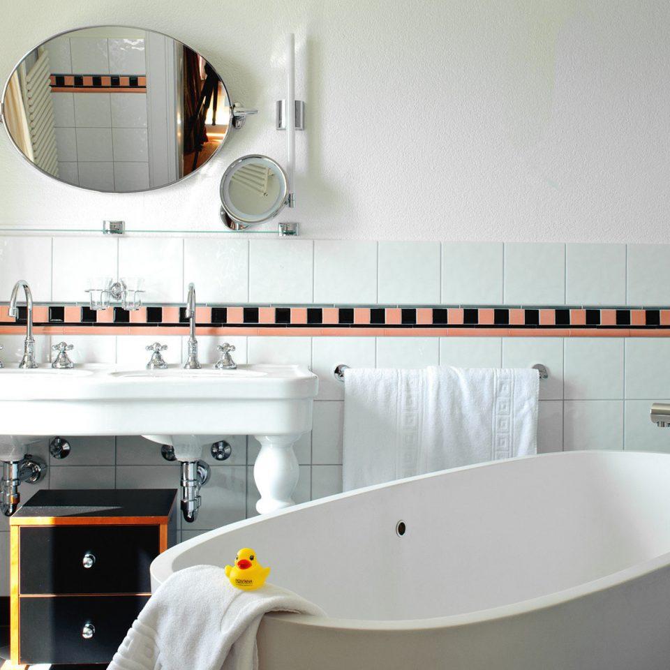 white property bathroom sink bathtub tub Bath tiled