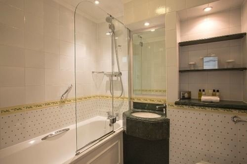 bathroom property sink toilet tub Bath bathtub tiled