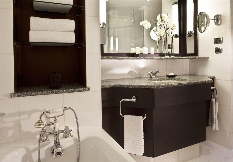 bathroom mirror sink property toilet towel home plumbing fixture flooring bidet cottage tile Bath