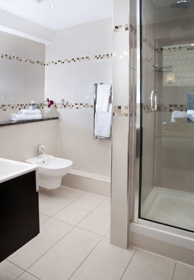 bathroom toilet property sink plumbing fixture flooring bidet public toilet vessel tile tub tiled Bath