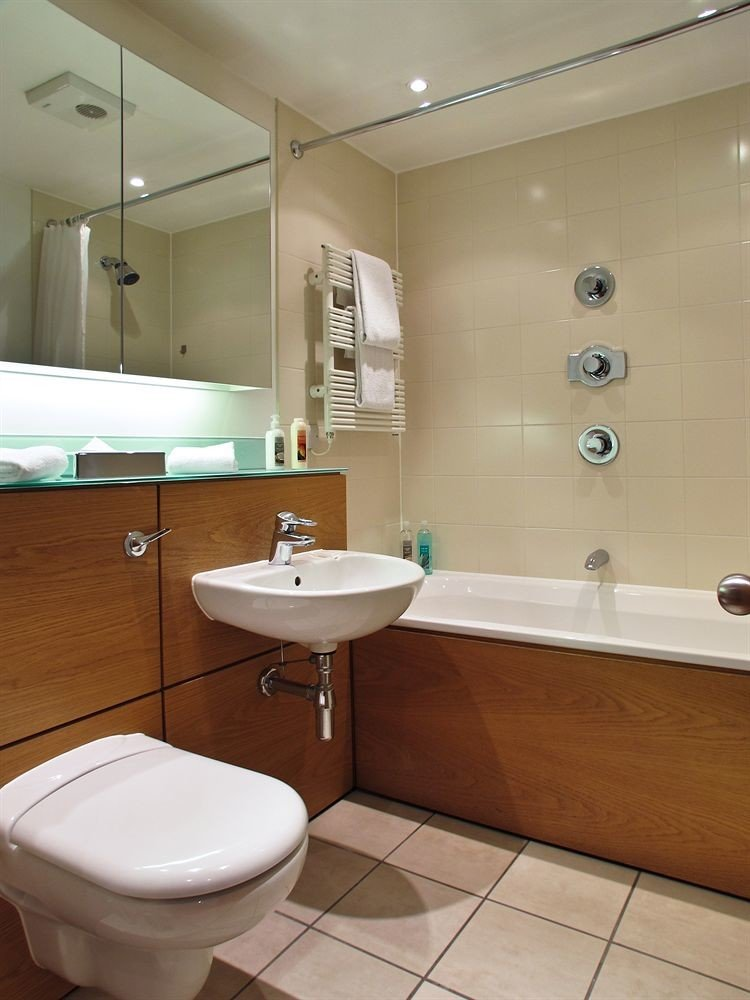 bathroom sink mirror property toilet plumbing fixture bidet tile tub tiled Bath