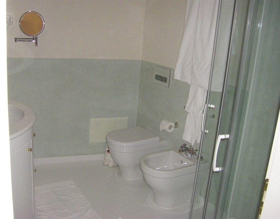 bathroom toilet property plumbing fixture white public toilet bidet Bath tub