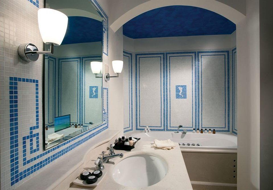 bathroom sink toilet blue property mirror home daylighting public toilet plumbing fixture Bath tiled