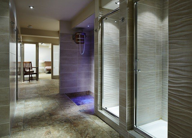 building bathroom property shower home plumbing fixture flooring glass tiled tile Bath stone