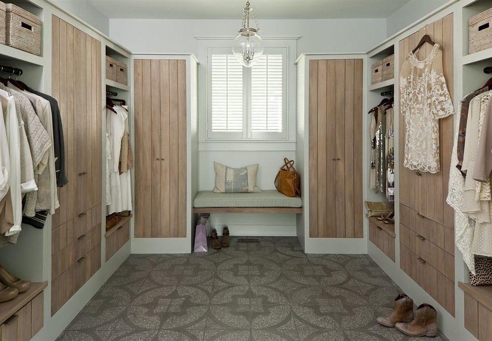 bathroom property home sink cabinetry hardwood flooring closet cottage tub Bath
