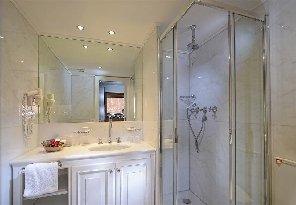 bathroom property white shower home cottage cabinetry plumbing fixture tub Bath