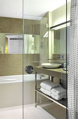 bathroom property sink shower flooring condominium tile plumbing fixture tub Bath tiled