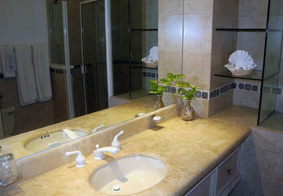 bathroom sink property countertop plumbing fixture home toilet counter flooring material cottage tile Bath