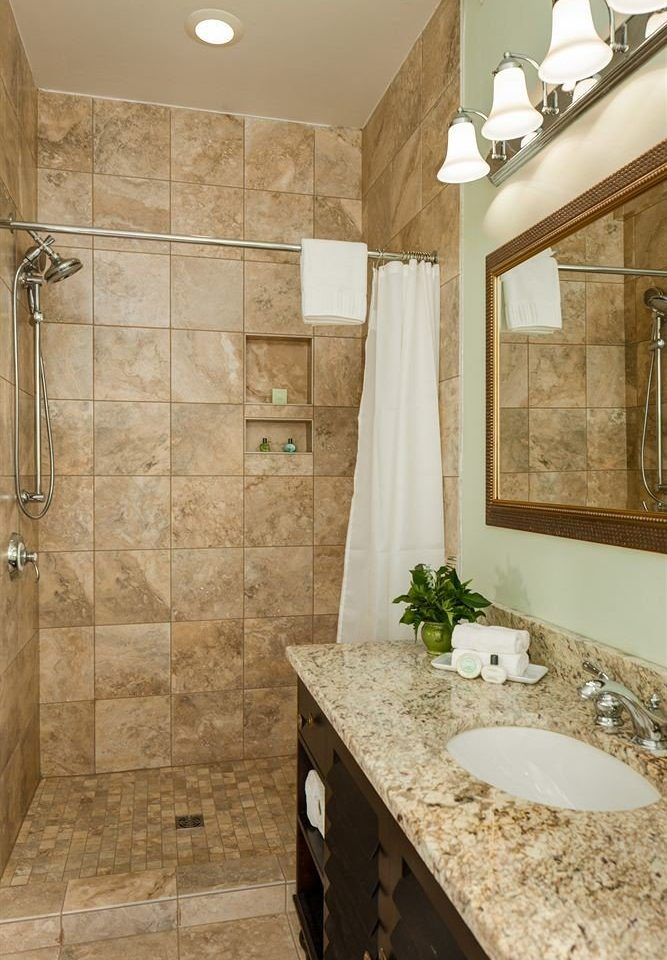 bathroom sink mirror property home countertop flooring counter plumbing fixture tile cottage farmhouse tan Bath