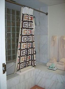 bathroom property stairs home living room cottage material curtain tiled tile tub Bath