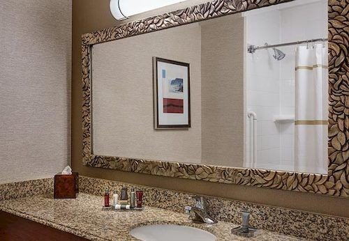 bathroom sink mirror property flooring home tile plumbing fixture cottage Bath tiled tub stone