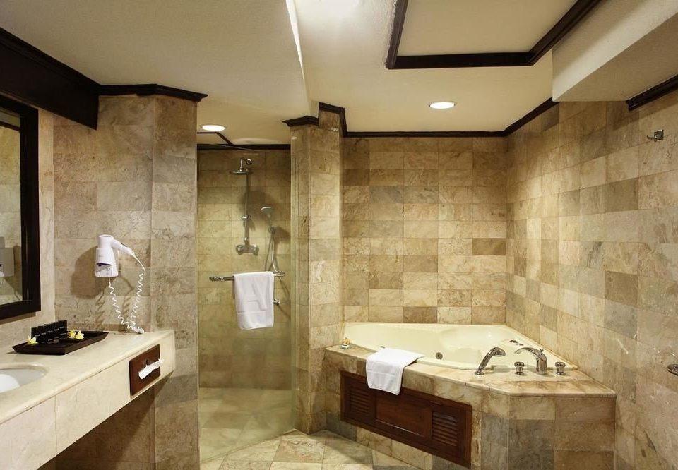 bathroom property sink home plumbing fixture flooring cottage tan stone Bath