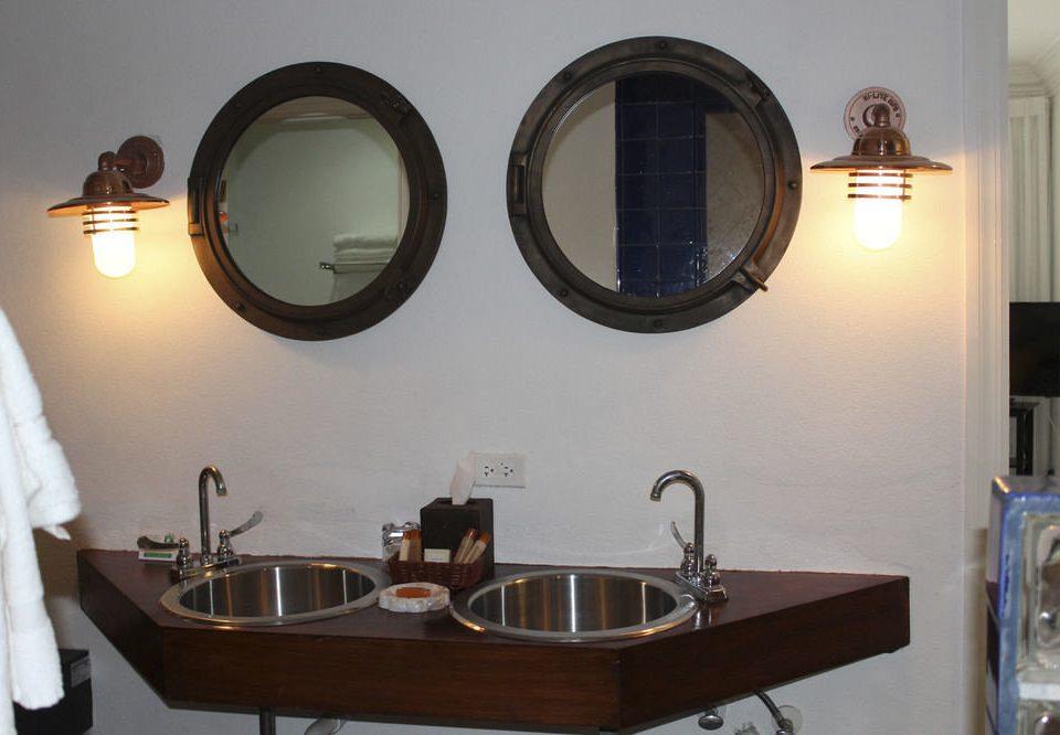 property mirror sink bathroom lighting home light fixture cottage Bath