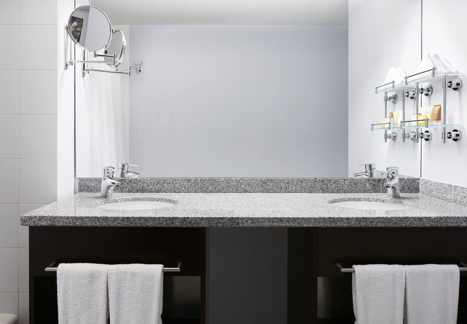 bathroom mirror sink white towel toilet plumbing fixture countertop vanity counter material tile rack tiled Bath