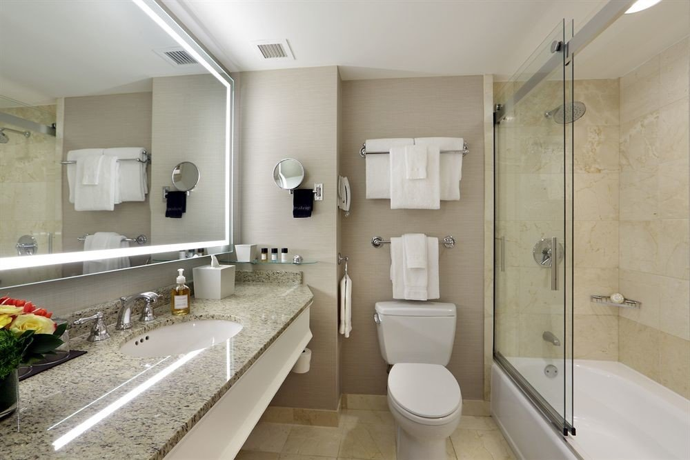bathroom mirror property sink toilet counter plumbing fixture tan Bath