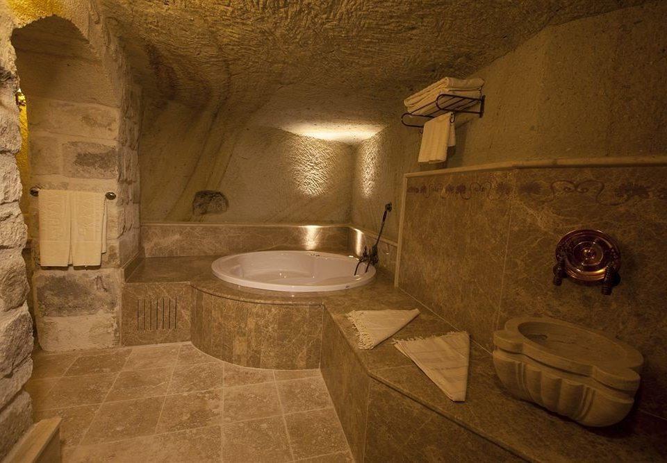 bathroom toilet sink crypt plumbing fixture stone tub Bath tile