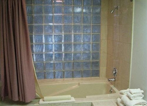 bathroom curtain plumbing fixture window treatment shower flooring tub Bath tiled