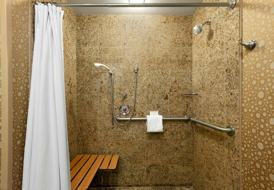 bathroom plumbing fixture flooring curtain tile shower towel Bath