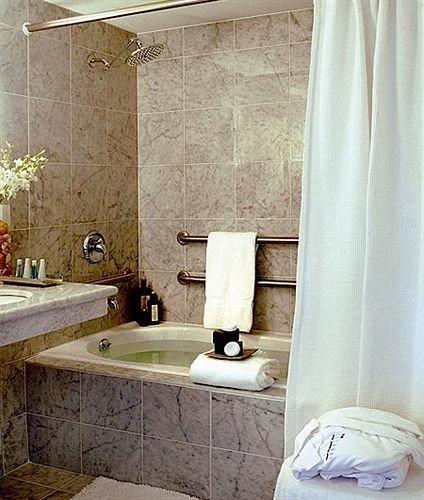 bathroom plumbing fixture sink curtain material textile Bath tub