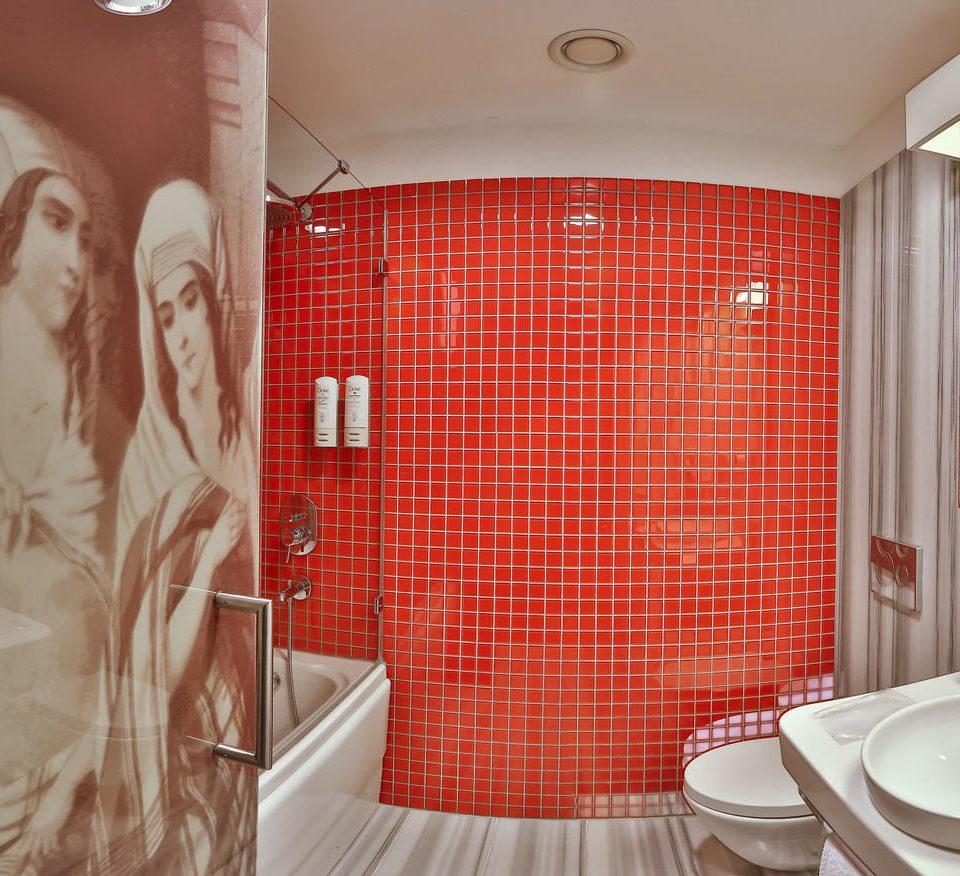 bathroom red toilet sink pattern curtain textile window treatment tiled tile tub Bath