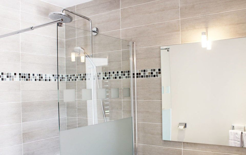 scene bathroom property plumbing fixture shower flooring glass tile tiled Bath