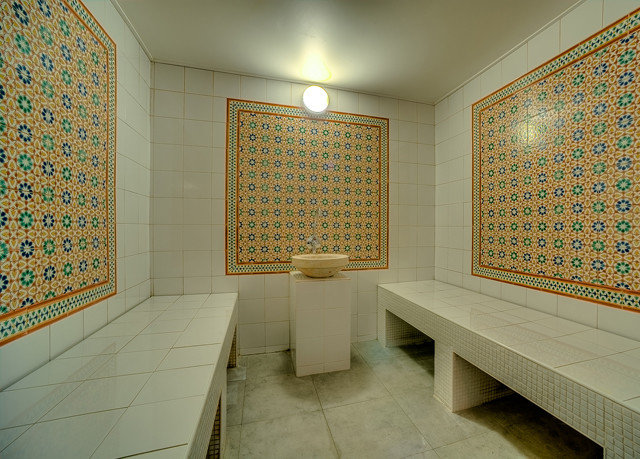 bathroom tiled flooring sink yellow tile hall plumbing fixture tourist attraction Bath tub