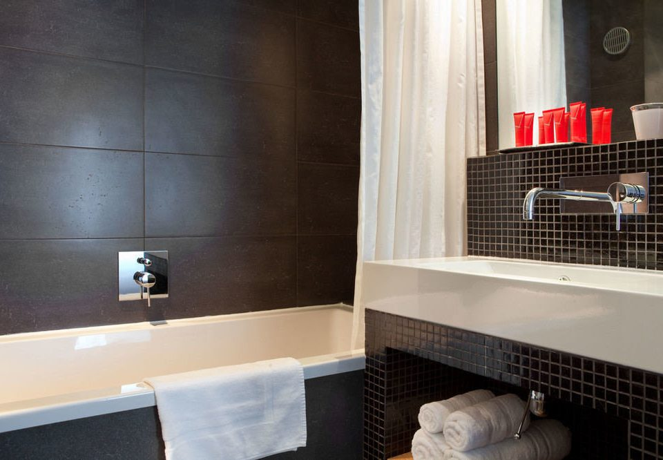 bathroom flooring plumbing fixture tile home tub tiled Bath
