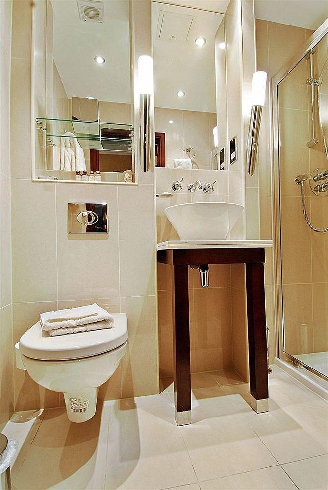 bathroom property toilet plumbing fixture home sink flooring Bath