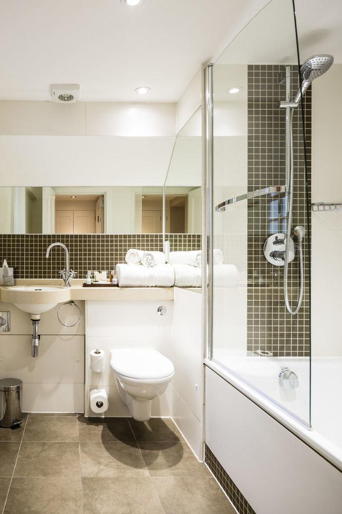 bathroom toilet property sink home flooring tile tiled Bath