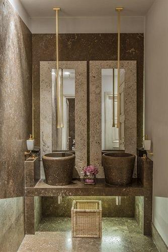 bathroom plumbing fixture lighting flooring tile living room stone Bath