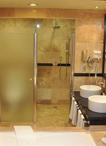 bathroom sink mirror property shower plumbing fixture flooring tile toilet stall Bath