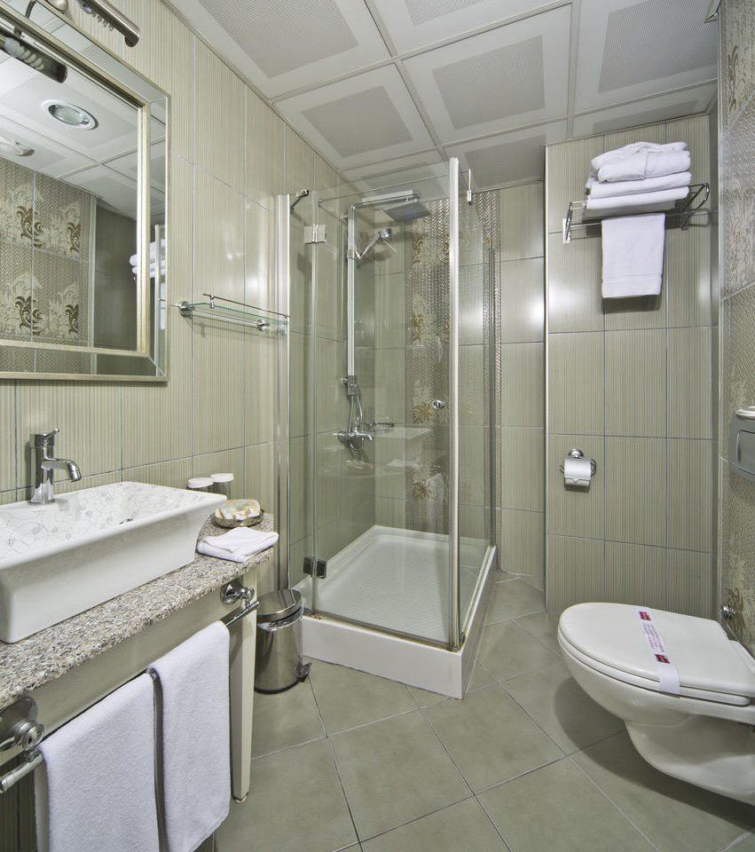 bathroom mirror property sink toilet public toilet plumbing fixture flooring tile Bath tiled