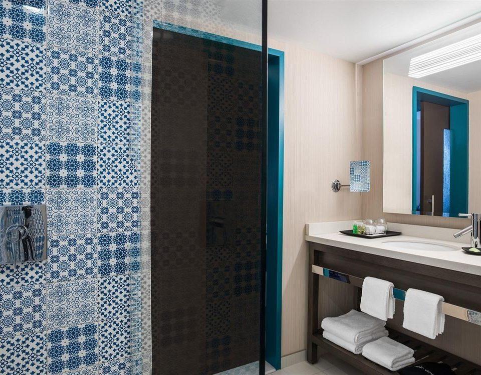 bathroom sink mirror shower plumbing fixture tiled flooring tile tub Bath