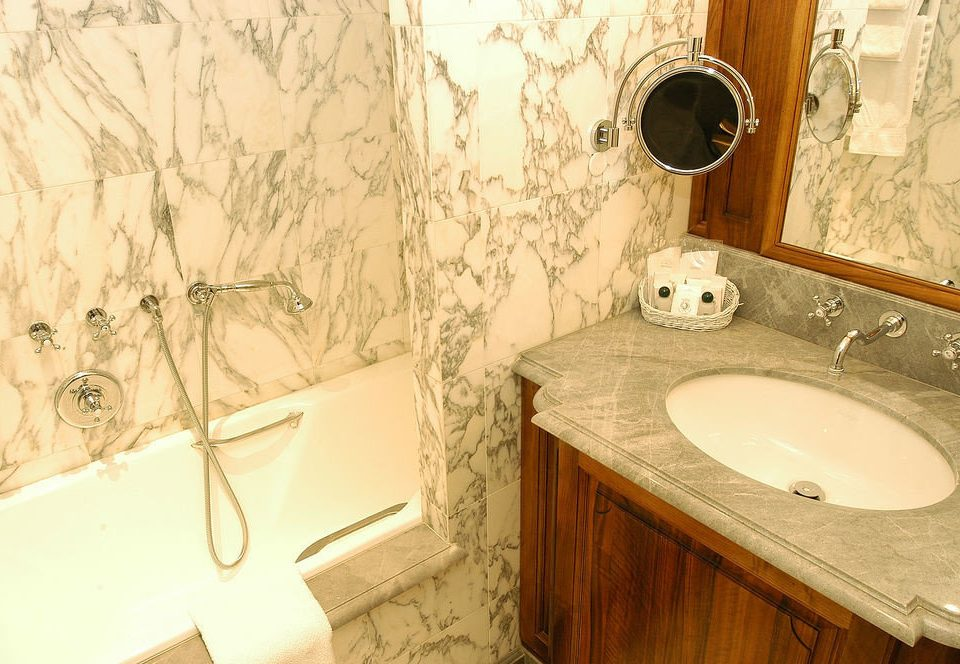 bathroom sink toilet plumbing fixture flooring Bath