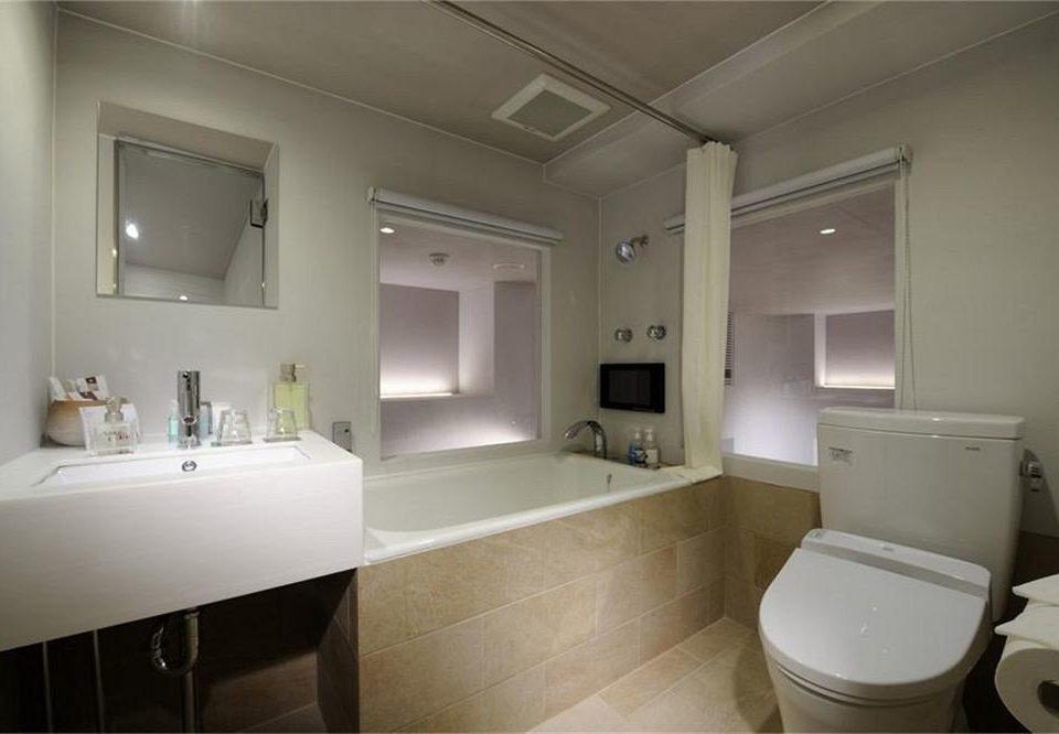 bathroom sink property mirror toilet home tub Bath tan