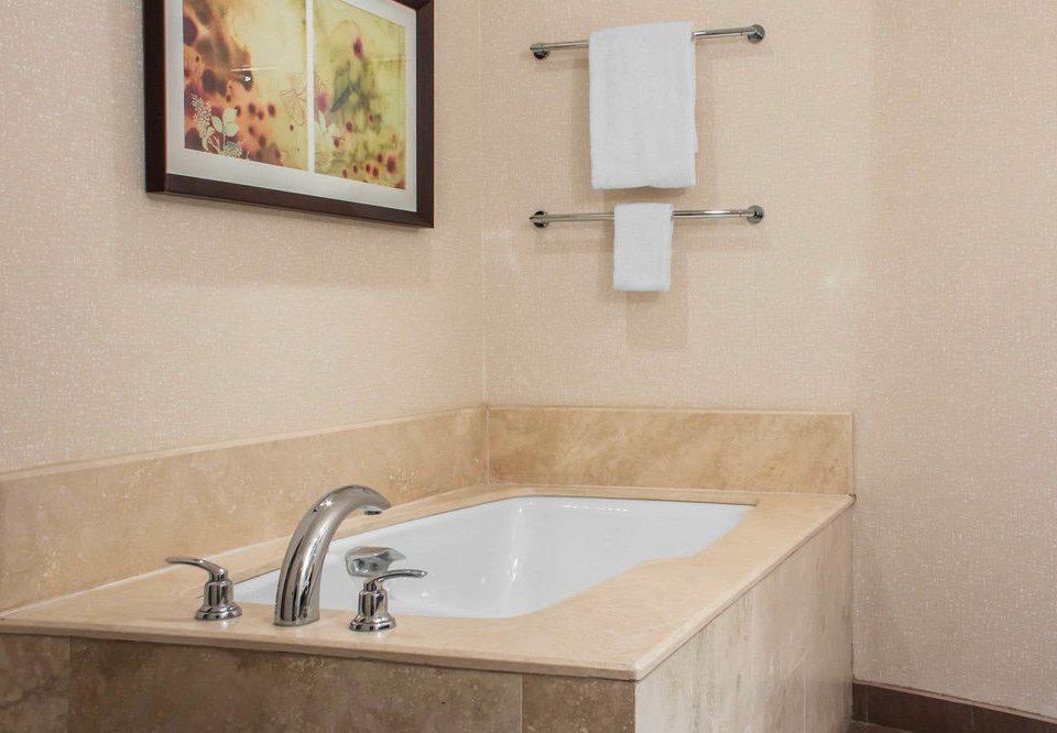 bathroom property sink vessel plumbing fixture home water basin tub tan Bath tiled