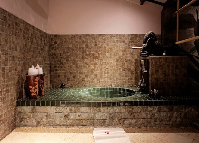 bathroom property tiled swimming pool sink tile jacuzzi plumbing fixture Bath