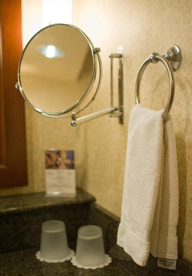 bathroom mirror towel toilet sink plumbing fixture lighting shower rack Bath