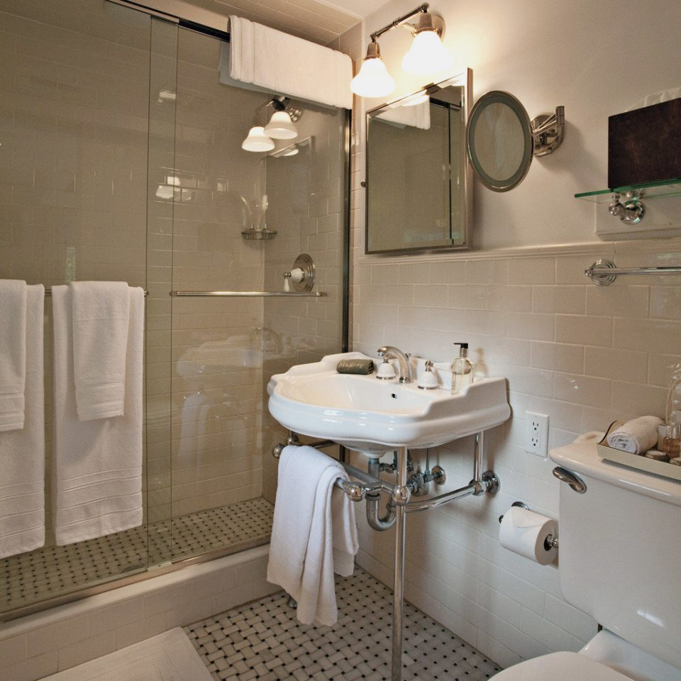 Bath Beach Boutique Inn Romance Romantic bathroom sink mirror property towel toilet home Suite cottage tile tub tiled bathtub