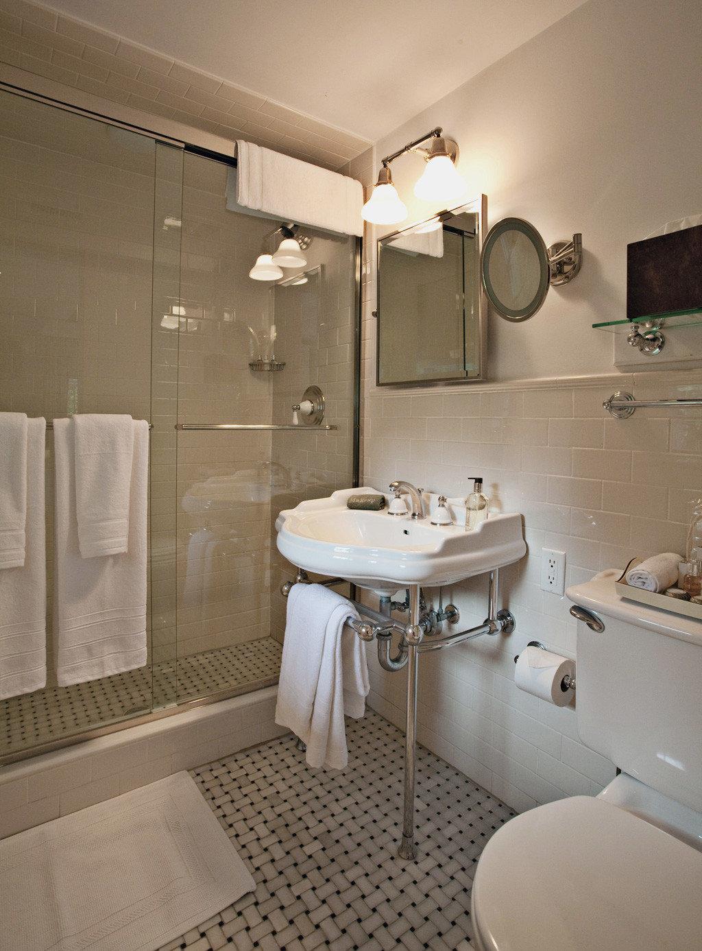 Bath Beach Boutique Inn Romance Romantic bathroom sink mirror property towel toilet home Suite cottage tile tub tiled bathtub