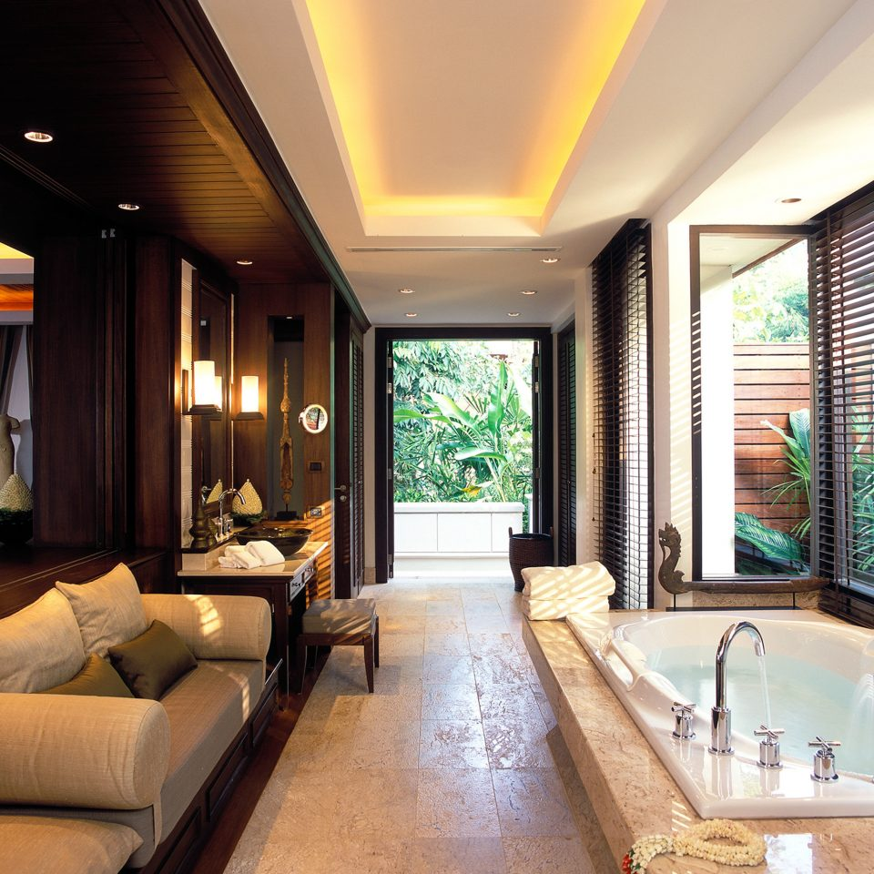 Bath Beach Elegant Hip Hotels Luxury Modern Phuket Thailand sofa property swimming pool Suite condominium living room home Resort mansion Villa Lobby stone